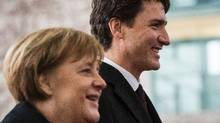 German Chancellor Angela Merkel (L) and Canadian prime minister Justin Trudeau are seen prior to a meeting at the Chancellery in Berlin on February 17, 2017.