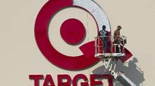 Workers install an outdoor sign at the new Target store at the Mic Mac Mall in Dartmought, N.S. (Andrew Vaughan/The Canadian Press)