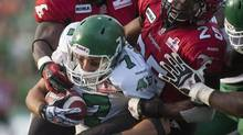 Saskatchewan Roughriders slotback Weston Dressler is tackled in the first half of CFL pre-season action against the Calgary Stampeders in Regina, Sask., Friday, June 22, 2012. (Liam Richards/THE CANADIAN PRESS)