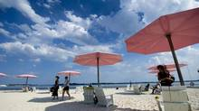 People take in the sun at Sugar Beach in Toronto in this 2012 file photo. (Nathan Denette/THE CANADIAN PRESS)