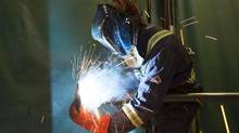 A welder works on a job in Calgary. Statscan said Friday that the Canadian economy added 11,000 new jobs in November, with part-time gains offsetting declines in full-time employment. (TODD KOROL/REUTERS)