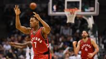 Toronto Raptors guard Kyle Lowry (7) reacts after scoring a basket in the third quarter during the game against the Milwaukee Bucks at BMO Harris Bradley Center on March 15, 2016. (Benny Sieu/USA Today Sports)