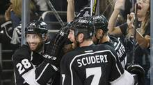 Los Angeles Kings' Dustin Penner (2nd L) celebrates his second period goal with Jarret Stoll (L-R), Rob Scuderi, and Jeff Carter against the St. Louis Blues during Game 6 of their NHL Western Conference quarter finals hockey playoff in Los Angeles, California May 10, 2013. (Lucy Nicholson/REUTERS)