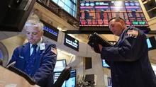 Traders on the floor of the New York Stock Exchange on Monday, July 23, 2012 in New York. (Henny Ray Abrams/Associated Press)