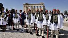 Greek presidental Evzoni guards stand atop the Acropolis archaeological site in Athens recently. (LOUISA GOULIAMAKI/AFP/Getty Images/LOUISA GOULIAMAKI/AFP/Getty Images)