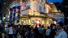 Passers-by enjoy a Christmas decoration in downtown Sao Paulo on Dec. 7, 2011. Brazil has the potential to be among the top five global economies by 2050, according to Goldman Sachs. (NELSON ALMEIDA/NELSON ALMEIDA/AFP/GETTY IMAGES)