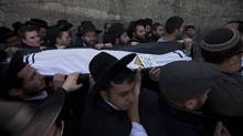 Family members and friends carry the body of Rabbi Jonathan Sandler during the March 21 funeral in Jerusalem of victims of Monday's shooting in Toulouse, France. (Oded Balilty/AP/Oded Balilty/AP)