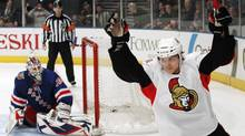 In this March 24, 2011 file photo, Ottawa Senators' Erik Karlsson, right, celebrates after scoring in a shootout against the New York Rangers, in New York. (Frank Franklin II/The Canadian Press)