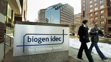 Two women pass Biogen Idec in Cambridge, Mass. in this file photo. Irish drug maker Elan said on Monday it would give shareholders 20 per cent of future royalties from multiple sclerosis drug Tysabri, in which it holds a 50-per-cent interest that it plans to sell to its U.S. partner Biogen. (ELISE AMENDOLA/AP)