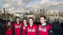 Members of the Canadian snowboard team Maelle Ricker, left to right, Mark McMorris, Spencer O'Brien, Sebastien Toutant and Chris Robanske pose for a photo following the team announcement in Vancouver, Friday, Jan. 3, 2014. (JONATHAN HAYWARD/THE CANADIAN PRESS)