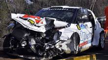 The wrecked car of Formula One driver Robert Kubica, of Poland, is towed in Andora, Italy, Sunday, Feb. 6, 2011. Kubica was injured Sunday in a rally car accident in Italy just weeks before the start of the new Grand Prix season, his Lotus Renault team and health authorities said. (Roberto Ruscello/AP Photo)