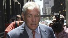 Conrad Black leaves his bail hearing in Chicago on Friday after his release from prison on a $2-million bond. (John Gress/REUTERS/John Gress/REUTERS)