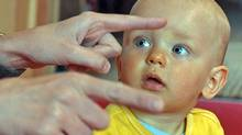 A baby looks at a mother making signs during a lesson to show Polish mothers how to communicate with their babies using sign language. (JANEK SKARZYNSKI/Janek Skarzynski/AFP/Getty Images)
