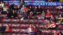 Fans are seen amongst many empty seats as Team Canada takes on Team Europe during first period World Cup of Hockey finals action in Toronto on Tuesday, September 27, 2016. THE CANADIAN PRESS/Frank Gunn