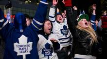 Fans celebrate as the Toronto Maple Leafs score the first goal in the third period as they take on the Boston Bruins during Game 6 of the Eastern Conference quarter-final at Toronto's Maple Leaf Square on Sunday, May 12, 2013. (Michelle Siu for The Globe and Mail)