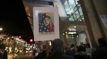 Protesters chant during a rally against Trump's immigration order at San Diego International Airport on March 6, 2017. (SANDY HUFFAKER/AFP/Getty Images)