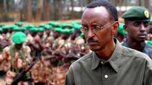 Rwandan President Paul Kagame inspects the 154 army troops during a ceremony in Kigali in this 2004 file photo. (FINBARR O'REILLY/REUTERS)