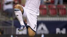 Whitecaps Camilo Sanvezzo scored a spectacular free kick goal on Wednesday to help Vancouver earn a 1-1 tie at Sporting Kansas City on Wednesday. (file photo) (JONATHAN HAYWARD/THE CANADIAN PRESS)