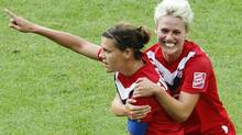 Canada's Christine Sinclair, left, is congratulated by her teammate Sophie Schmidt after scoring their side's first goal during the group A match between Germany and Canada at the Women?s Soccer World Cup in Berlin, Germany, Sunday, June 26, 2011. (AP Photo/Markus Schreiber) (Markus Schreiber/AP)