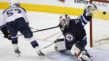 St. Louis Blues' David Perron (57) puts his penalty shot past Winnipeg Jets' goaltender Chris Mason (50) during the shot out to win their NHL game in Winnipeg on Saturday, February 25, 2012. THE CANADIAN PRESS/John Woods (JOHN WOODS)