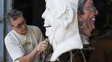 George Rammell at his workshop in Vancouver where he is reusing and rebuilding the sculpture of president Kris Bulcroft. (John Lehmann/The Globe and Mail)