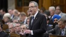 Finance Minister Joe Oliver tables the federal budget in the House of Commons on Parliament Hill in Ottawa, Tuesday April 21, 2015. (Adrian Wyld/THE CANADIAN PRESS)