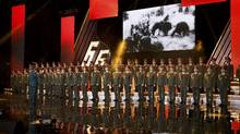 Singers and orchestra members of Red Army Choir, also known as the Alexandrov Ensemble, perform in Moscow, Russia March 31, 2016. (STRINGER/REUTERS)