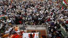 Baba Ramdev has confounded local police with his anti-graft protest, which has attracted thousands of supporters and onlookers. (Rajesh Kumar Singh/AP)