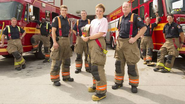 Breast cancer survivor Rayanne Dubkov and some of her firefighting colleagues who have raised money for the Louise Temerty Breast Cancer Centre. (Peter Power)