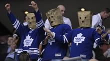 Toronto Maple Leafs fans wear paper bags on their heads during the third period of their NHL hockey game against the New York Islanders in Toronto March 20, 2012. (Mike Cassese/Reuters/Mike Cassese/Reuters)