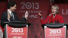 Federal Liberal Party leadership candidates Justin Trudeau, left, and Joyce Murray take part in the final leadership debate in Montreal on March 23, 2013. Both leadership candidates butted heads over the question of co-operating with other parties in strategic voting. (CHRISTINNE MUSCHI/REUTERS)