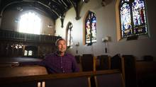 Minister Wes Denyer, who leads a refugee sponsorship group, is seen at the Rosedale Presbyterian Church in Toronto on Friday. His group has been offered a 'replacement' family (Mark Blinch for the Globe and Mail)