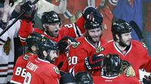 Chicago Blackhawks centre Michal Handzus (26) celebrates a game winning goal with his teammates during the second overtime period in Game 5 of the Western Conference finals in the NHL hockey Stanley Cup playoffs against the Los Angeles Kings, Wednesday, May 28, 2014, in Chicago. (Associated Press)