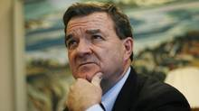 Finance Minister Jim Flaherty listens to a question during an interview in Ottawa Dec. 21, 2009. (CHRIS WATTIE/Chris Wattie/Reuters)
