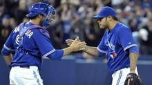 Toronto Blue Jays catcher J.P. Arencibia and pitcher Sergio Santos (R) celebrate their win against the Boston Red Sox during the ninth inning of their MLB American League baseball game in Toronto April 11, 2012. (MIKE CASSESE/MIKE CASSESE/REUTERS)