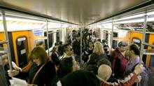 Commuters ride a Toronto Transit Commission subway. (Kevin Van Paassen/The Globe and Mail)