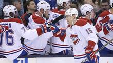 Montreal Canadiens left wing Tomas Fleischmann (15) celebrates with teammates after scoring in the first period against the Toronto Maple Leafs on Saturday, Jan. 23, 2016. (Tom Szczerbowski/USA Today Sports)