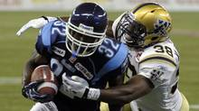 Toronto Argonauts running back Andre Durie is tackled by Winnipeg Blue Bombers linebacker Marcellus Bowman. (MIKE CASSESE/Reuters)
