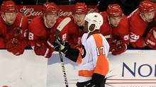 Philadelphia Flyers' Wayne Simmonds heads back to the bench after scoring on Detroit Red Wings goalie Jordan Pearce during the shoot out of pre-season NHL hockey action in London, Ontario, Thursday. (DAVE CHIDLEY/The Canadian Press)
