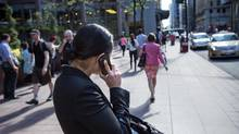 Bending your head to look down at a mobile device can put up to 60 pounds of pressure on your spine. (Fred Lum/The Globe and Mail)