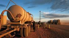 A worker transfers oil into a tank at an Enbridge facility outside Alexander, North Dakota. (Matthew Staver/Bloomberg/Matthew Staver/Bloomberg)