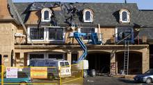 File photo of monster home under construction in Richmond, B.C. (JOHN LEHMANN/The Globe and Mail)