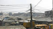 A scramble of power cables in Oshodi district of Lagos, Nigeria's largest city, on April 16, 2003. Nigeria is Africa's largest oil producer, but electricity blackouts occur daily. President Goodluck Jonathan has laid out plans to privatize electricity production and distribution in the nation of some 160-million people. (PIUS UTOMI EKPEI/AGENCE FRANCE-PRESSE)