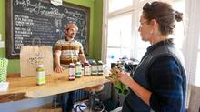 John Parlow, co-founder of Pulp & Press Juice Co., a small raw-juice company in London, Ont., conducted taste tests at his store there. (Glenn Lowson for The Globe and Mail)