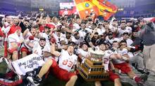 Laval University Rouge et Or's celebate with the Vanier Cup after defeating the McMaster University Marauders in CIS football action at the 48th Vanier Cup championship game in Toronto on Friday, Nov. 23, 2012. (Frank Gunn/The Canadian Press)