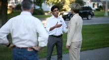Liberal candidate Yasir Naqvi, the incumbent, speaks with constituents while canvassing in his Ottawa Centre riding on August 26, 2011. (Dave Chan/Dave Chan for The Globe and Mail)