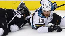 San Jose Sharks left wing Raffi Torres (13) looks up after hitting Los Angeles Kings center Jarret Stoll (28) to the ice during Game 1 of their NHL Western Conference semifinal playoff hockey game in Los Angeles, California, May 14, 2013. (DANNY MOLOSHOK/REUTERS)