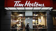 In an increasingly competitive cafe market, Tim Hortons franchises like the one shown here at the corner of Simcoe and Richmond streets in Toronto will need to update their menu options to better serve customers. (FRED LUM/THE GLOBE AND MAIL)