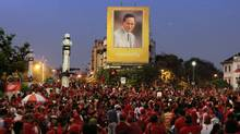 Supporters of ousted prime minister Thaksin Shinawatra gather under a giant portrait of King Bhumibol Adulyadej in Bangkok on March 13. (Sakchai Lalit/Sakchai Lalit/AP)
