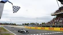Mercedes Formula One driver Lewis Hamilton crosses the finish line during the Spanish F1 Grand Prix at the Barcelona-Catalunya Circuit in Montmelo, May 11, 2014. (SERGIO CARMONA/REUTERS)